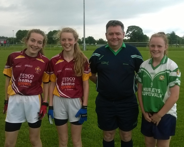 Mary Leahy Aghada Captain with Youghal Captains and Ken Whelan Referee