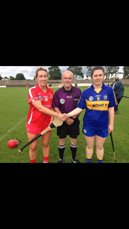 Cork Camogie Captain Jennifer Barry & Tipperary Captain Michaela Graham with referee Philip Dee prior to the Munster intermediate Camogie Final played in Bruff.
