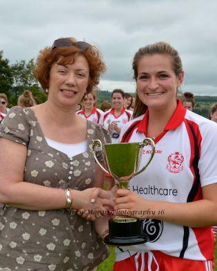 AIB Bank Fermor Branch Managet Máire Barry presents the ECB Senior Championship trophy to Sarah Harrington Inch Rovers Captain