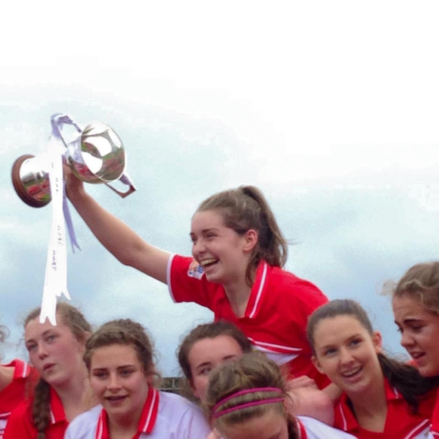Grace Culloty raising the Minor Ladies All Ireland Football Cup