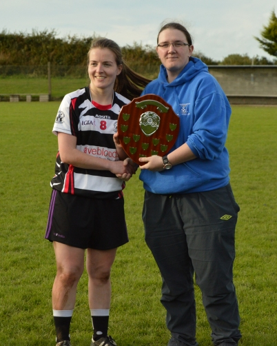 Our inspirational captain Ciara accepting the Phil McCarthy Trophy from Phil