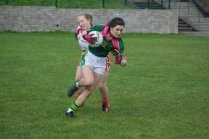Ellen Twomey bursting out of the inch defence.